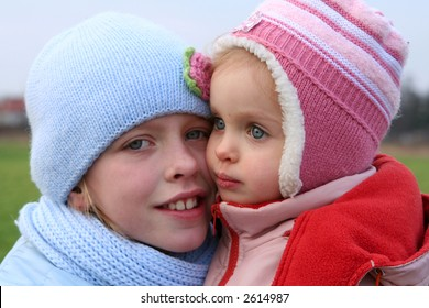 Happy children in winter outfit  ona background of field