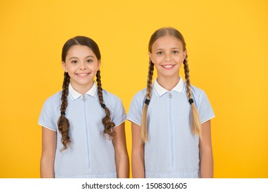 Happy childrens day. Equal protection civil rights and freedom from discrimination. Perfect schoolgirls. Schoolgirls vintage simple style outfit. Cheerful schoolgirls yellow background. Little girls.