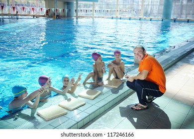 happy childrens group  at swimming pool class  learning to swim
