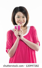 Happy Chinese girl with a gift in her hand