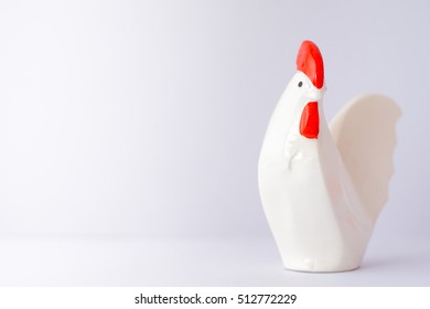 Happy Chinese new year 2017 with rooster, animal symbol of new year 2017. Ceramic chicken