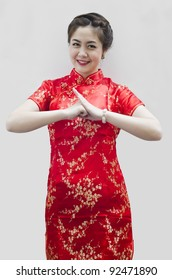happy Chinese new year. beautiful young Asian woman with gesture of congratulation
