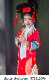 Happy Chinese new year concept . smiling little girls Traditional Chinese dress.