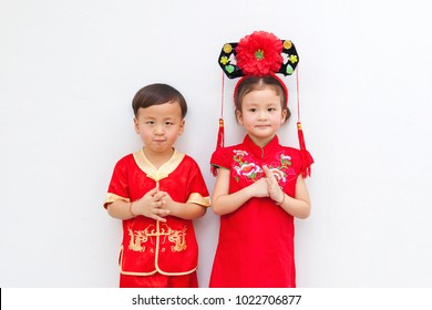 Happy chinese new year. Little asian boy and girl with Congratulation gesture. Text mean Happiness and Lucky. Portrait. Space.