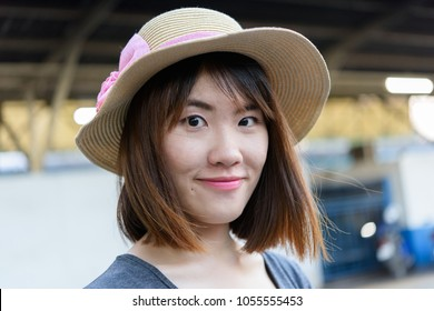 Happy chinese teenage girl with smiling face ready for travel