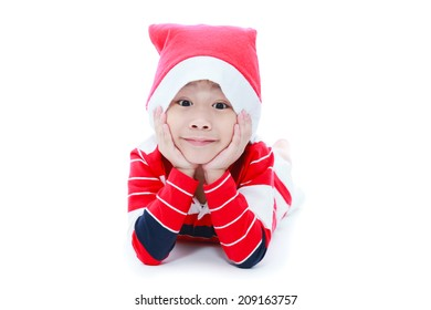 Happy christmas boy laying and smiling in santa hat on white background
