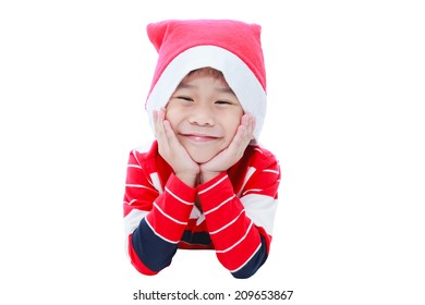Happy christmas boy laying and smiling in santa hat ,isolated on white background