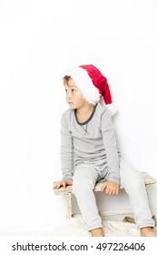 Happy christmas boy in Santa hat on white background