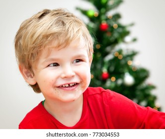 Happy Christmas  Cute Toddler Series with Gifts and Tree in his Modern Home with wooden floor and white walls: Portrait