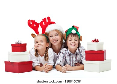 Happy christmas people family with presents laying on the floor - isolated
