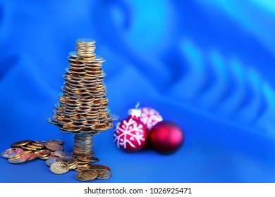 Happy  Christmas tree with golden coins, business metaphor