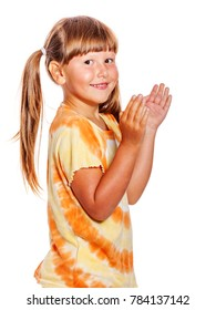 Happy clapping six years girl portrait isolated