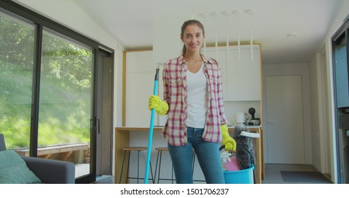 Happy cleaning service employee ready to start working, positive work attitude.