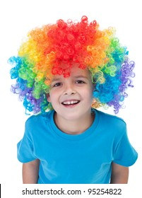 Happy clown boy with large colorful wig - isolated