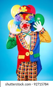 Happy clown over the blue background