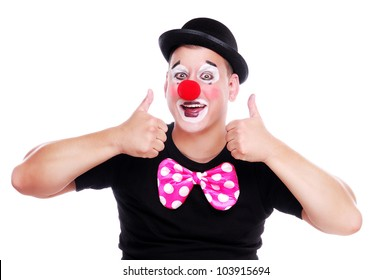 Happy clown showing thumbs up gesture on white background