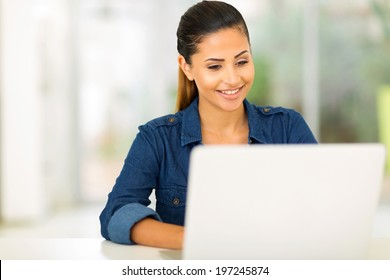 happy college student using laptop computer
