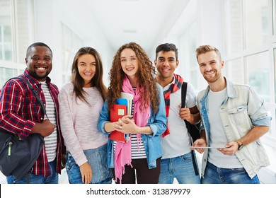 Happy college students looking at camera with smiles