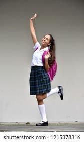 Happy Colombian Female Student Wearing Uniform