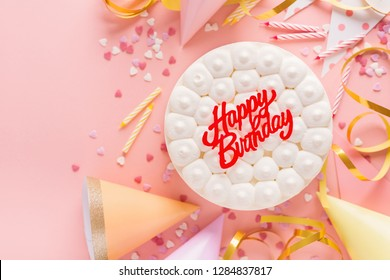 Happy colorful birthday party background with birthday cake and party accessorizes. Top View with copy space. Pink Background. Horizontal