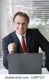 A happy confident man in suit.