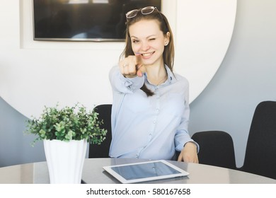 Happy confident office worker successful smiling,point with hand to camera,shows to you,you are next.Woman won
