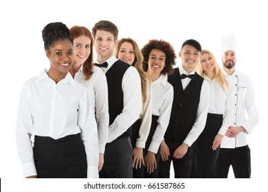 Happy Confident Restaurant Staff Standing In Row Against White Background