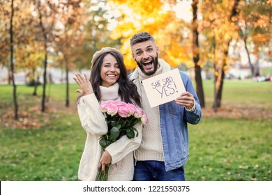 Happy couple after making proposal in autumn park