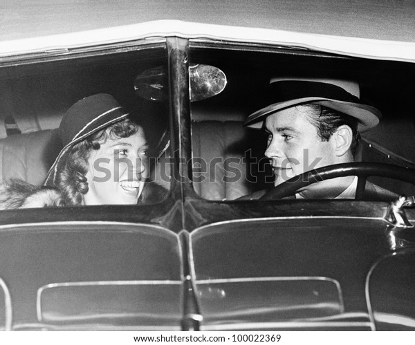 Happy couple in antique car