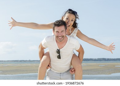 a happy couple at the beach