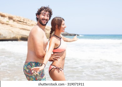 happy couple in a beach
