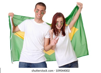 Happy couple with Brazil flags on their cheeks holds Greece flag, isolated