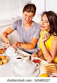 Happy couple breakfast at kitchen.