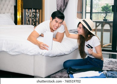 Happy couple to business trip travel prepare luggage on during long Weekend.