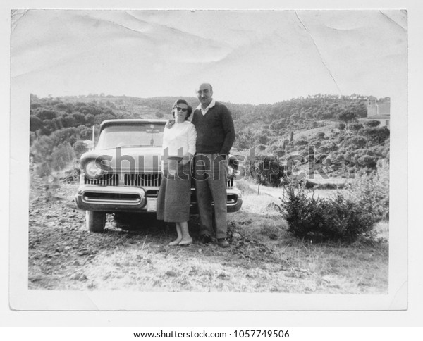 Happy couple and car in 1950
