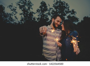 Happy Couple celebrating with Sparkler Firworks