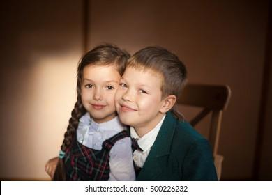 happy couple of children in school uniform