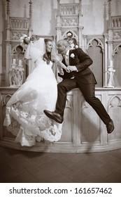 Happy couple in church in monochrome tones
