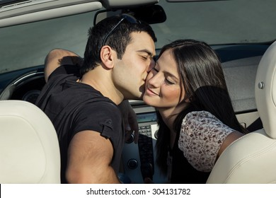 Happy Couple In Convertible Car