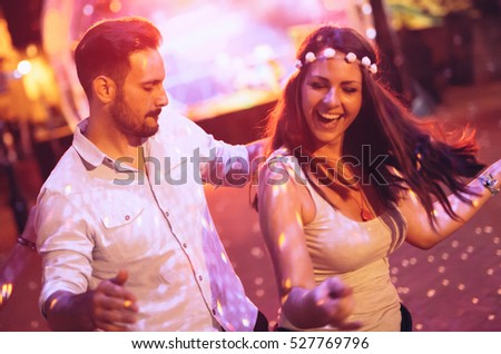 Happy couple dancing in club