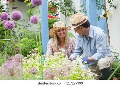 Happy couple doing the gardening at home