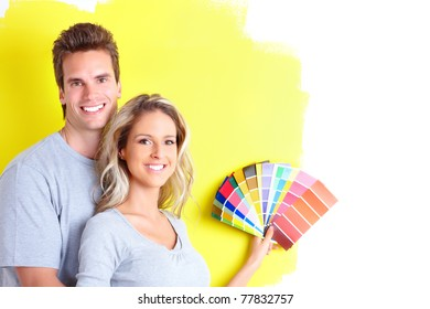 Happy couple doing renovation at home. House decoration.