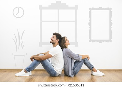 The happy couple dream near the wall with a symbols