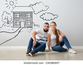 Happy couple dreaming about moving into new house