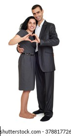 Happy couple dressed in strong classic dress, making heart shape from fingers, studio portrait on white