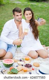 Happy couple drink wine. Summer holiday idyllic.