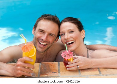 Happy couple drinking cocktails