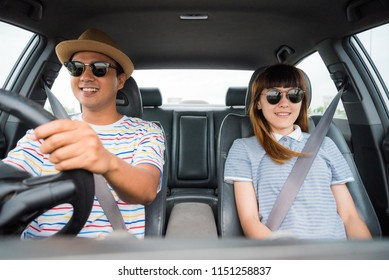 Happy couple driving in car. Enjoying travel concept.