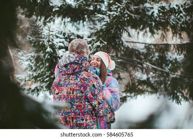happy couple embrace and love in the winter forest