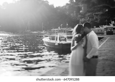 happy couple embrace in  port in Italy